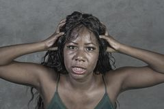 Young crazy desperate and anxious black african American woman feeling stressed and tormented in intense and dramatic face express. Ion isolated on studio stock photos