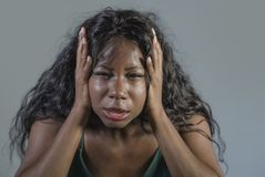 Young crazy desperate and anxious black african American woman feeling stressed and tormented in intense and dramatic face express. Ion isolated on studio royalty free stock images