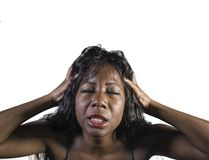 Young crazy desperate and anxious black african American woman feeling stressed and tormented in intense and dramatic face express. Ion isolated on studio stock photography
