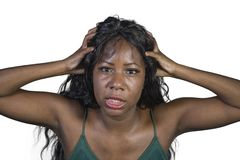Young crazy desperate and anxious black african American woman feeling stressed and unwell in intense and dramatic face expression. Isolated on studio royalty free stock images