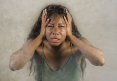 Young crazy desperate and anxious black african American woman feeling stressed and unwell in intense and dramatic face expression. Isolated on studio royalty free stock photo