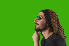 Young crazy man. Isolated over green background Royalty Free Stock Images