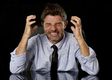 Young crazy stressed businessman in worried tired face expression screaming desperate Royalty Free Stock Photo