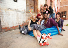 Young and crazy teens playing Royalty Free Stock Image