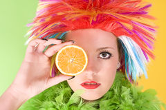 Young crazy woman with colorful hair and orange Royalty Free Stock Photos