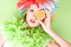 Young crazy woman with colorful hair and orange Royalty Free Stock Image