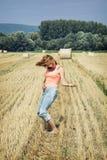 Young crazy woman imitates guitar play at the field Stock Photos