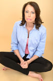 Young Crazy Woman Sitting on the Floor Stock Photography