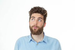 Young creative boy thinking about something. Bearded man with a pensive expression in his office posing on a white background Stock Photos