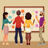 Young creative business people brainstorming ideas at the board Royalty Free Stock Images