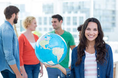 Young creative business people with a globe Royalty Free Stock Photo