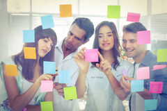 Young creative business people looking at the photo editor royalty free stock photography