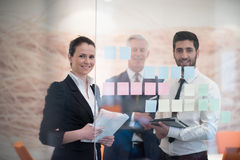 Young creative business people with senior ceo Stock Images