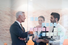 Young creative business people with senior ceo Stock Photography