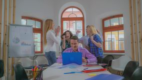 Young creative business team receive good news. Group of people celebrating good news. Victory dance and happy jubilation. Smiling professional staff jumping royalty free stock photos