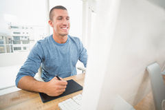 Young creative businessman drawing on graphic tablet Stock Photos
