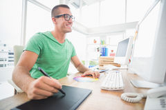 Young creative businessman drawing on graphic tablet Stock Photo
