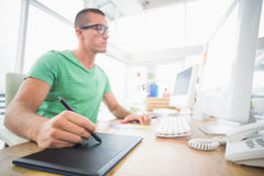 Young creative businessman drawing on graphic tablet Stock Image