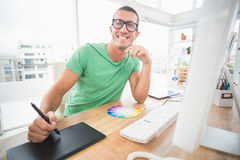 Young creative businessman drawing on graphic tablet Royalty Free Stock Images