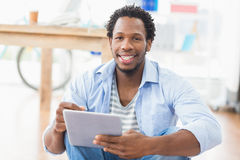 Young creative businessman scrolling on the tablet Royalty Free Stock Images