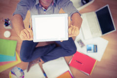 Young creative businessman showing his tablet Royalty Free Stock Image