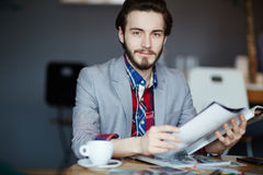 Young Creative Businessman Working at Table Stock Photo