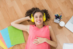 Young creative businesswoman enjoying music Stock Image