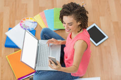 Young creative businesswoman holding a smartphone Royalty Free Stock Image