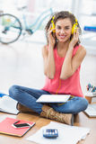 Young creative businesswoman listening to music Stock Images