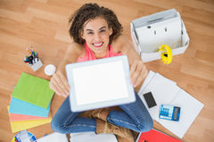 Young creative businesswoman showing her tablet Royalty Free Stock Photo
