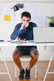 Young creative designer man working at office and drinking coffee. Stock Image