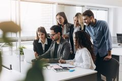 Young creative managers team working with new project in modern office royalty free stock image