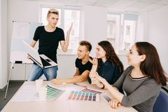 Young creative men and women discussing new ideas. Developers and designers team communication. young men and women discussing new ideas. information exchange royalty free stock photo