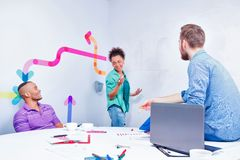 Young creative people at brainstorming Royalty Free Stock Photos