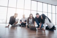 Young creative people in modern office. Group of young business people are working together with laptop. Freelancers royalty free stock photography