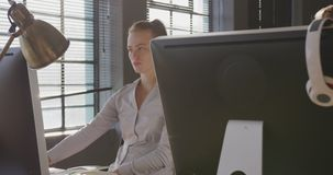 Young creative professional working in a modern office stock footage
