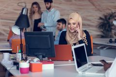 Young creative startup business people on meeting at modern office making plans and projects royalty free stock image
