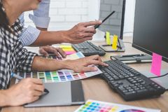 Young creative team having a meeting in creative office, Architectural drawing with work tools and accessories, Color swatch. Samples chart for selection stock photo