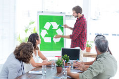 Young creative team having a meeting about recycling stock photo