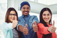 Young creative team showing thumbs up Royalty Free Stock Photography