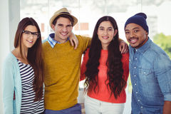 Young creative team smiling at camera Royalty Free Stock Photography