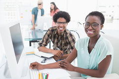 Young creative team working at desk Royalty Free Stock Images