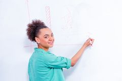 Young creative woman at brainstorming Royalty Free Stock Photos