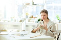 Woman in workroom Stock Photo