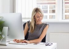 Young creative woman working with computer Stock Image