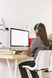 Young creative woman working at office. Desk of a creative worker royalty free stock photo