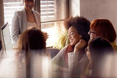 Young creative women designer having a meeting stock photo