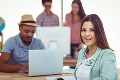 Young creative workers smiling at camera Stock Photos