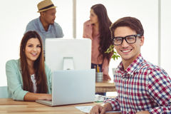 Young creative workers smiling at camera Royalty Free Stock Image