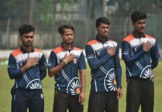 Young cricketers are showing respect to the National Anthems stock image